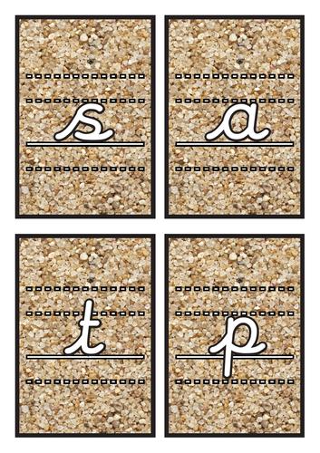 Lined Cursive Phase 2 Phonics Flashcards on Sand Background